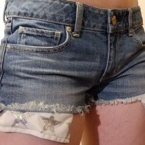 American Eagle denim shorts gold star pockets